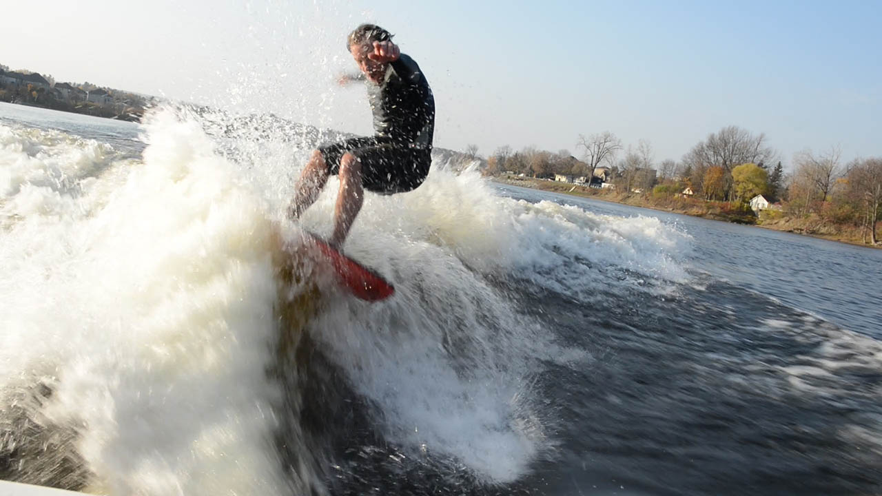 Wake Surfers Wake Surfing in Freezing Cold Water